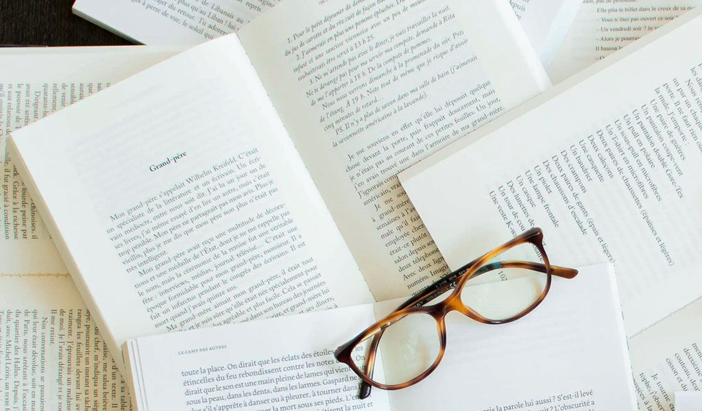 Glasses and books by Marylou Fortier